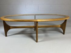 Mid Century teak and glass oval coffee table, approx 130cm x 60cm x 42cm