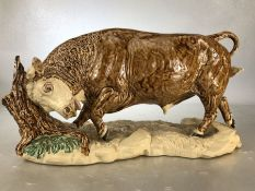 Ceramic figure of a bull by Heredities, approx 37cm in length