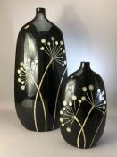 Two modern black ceramic vases, the tallest approx 58cm in height