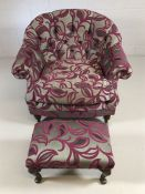 Contemporary upholstered low bedroom chair on front castors with matching foot stool
