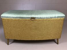 Gold Lloyd loom style ottoman on tapering legs with blue upholstered seat