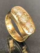 9ct Gold boat ring set with five graduated Diamonds the central diamond approx 0.25ct size 'S'