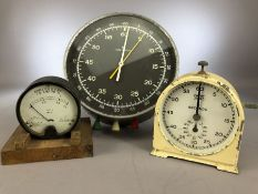 A mid 20th Century German darkroom stop clock / timer by Junghans, of circular form with luminous
