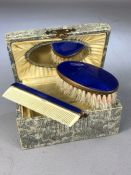 Boxed travel set of Brush and comb set with Blue enamel detaing and Brass frames, box (approx 11 x 7