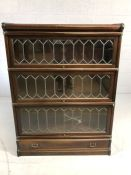 Four section early Globe Wernicke cabinet / book shelves with brass fitments, leaded glass and