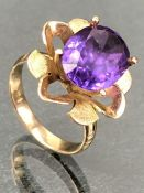 14k Gold ring with Petals and four claw mount for a faceted Amethyst approx 11mm in length