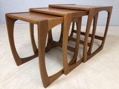 Nest of three Mid Century teak coffee tables