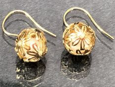 Pair of 9ct Gold earrings of delicate hollow gold balls set with diamonds and each encasing a