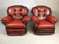 Pair of red leather armchairs (one recliner) by THOMAS LLOYD