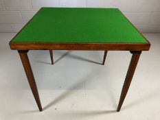 Card table with folding legs and 'as new' green baize