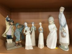 Collection of six figurines to include Lladro and Nao