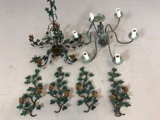 Two metal ornate chandeliers, one a six branch and the other a five branch with wall sconces
