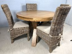 Light wood contemporary circular dining room table on three solid wooden legs, approx 120cm in