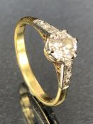 Diamond solitaire ring set with diamond shoulders size 'L'