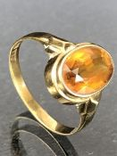 8ct Gold ring set with a faceted oval Citrine approx 'O'