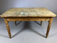Rustic plank topped pine table on turned legs with paint splatters to top, approx 124cm x 85cm x