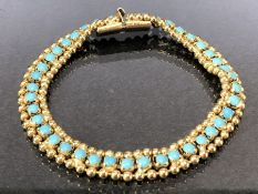 Gold coloured bracelet with gold beaded edge supporting Turquoise stones approx 18cm long