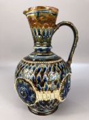 Doulton of Lambeth Baluster shaped water jug decorated in coloured enamels and with impressed