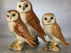 Collection of three Beswick Owls: the largest marked 1046, approx 19cm in height, and two smaller