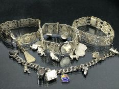 Collection of four silver and silver coloured metal bracelets some with silver coins and charms