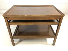 Interesting oak serving table / coffee table with detachable tray to base and extending trays to the