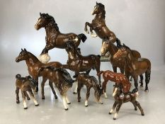 Collection of 11 Beswick horses of varying heights, to include New Forest Pony, rearing Welsh Cob,