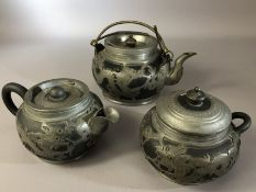 Chinese pewter and pottery part tea set by Hsin Ho Cheng, tallest approx 10.5cm (one teapot handle