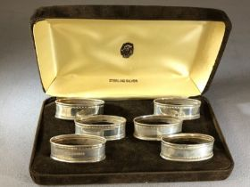 Boxed set of six silver hallmarked napkin rings in presentation case