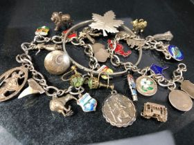 Collection of silver items to include two charm bracelets