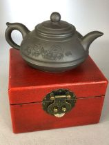 Boxed Yixing Chinese teapot with impressed character marks to base