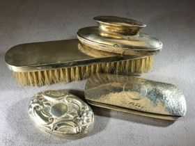 Collection of hallmarked silver items to include a clothes brush, hammered glasses case, nail file