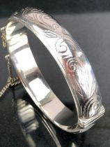 Silver hallmarked christening bangle decorated with floral sprays approx 20g