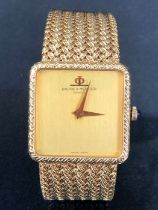 BAUME & MERCIER GENEVE swiss made 18ct Gold wristwatch with woven 18ct Gold strap. Plain gold face