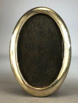 Oval Silver hallmarked Photoframe with wooden back (hallmarks indistinct) approx 15cm tall