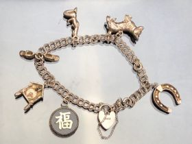 Silver Charm Bracelet with silver chinese token, and silver heart shaped lock