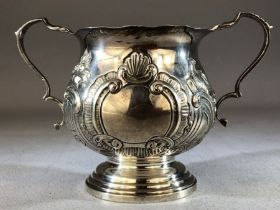 Silver hallmarked loving cup with two repousse design on a stepped base Birmingham Walker & Hall