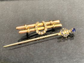 Two Gold coloured horse themed jewellery items, Hat pin and a brooch both set with lucky horse
