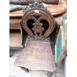 Carved oval backed hall chair on 4 tapering turned feet