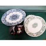 3 oval meat plates and a pair of wall plates each of a lady in traditional dress