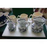 Set of 3 Masons white and black ground fine stone graduated jugs decorated Pergoda scenes and 3
