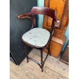 Bow backed high chair the padded seat upholstered in beige floral cloth