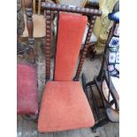 Edwardian high twist stemmed backed hall chair on brass casters,