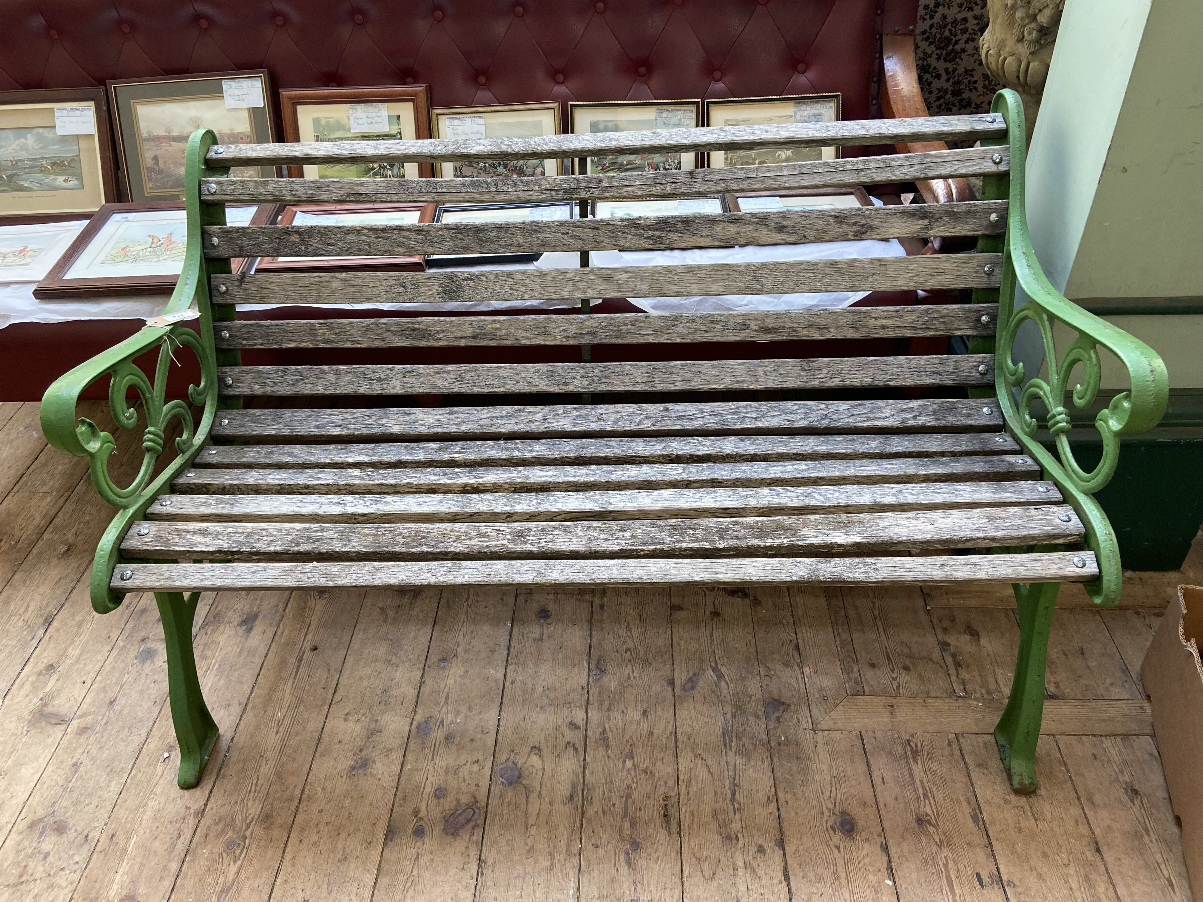 "Green painted metal framed garden seat (48"" wide)"