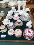 Magpie lot of miniature china cups and saucers from various factories,