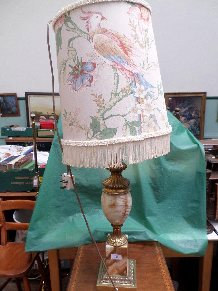 Ornate veined yellow onyx and brass table lamp with floral patterned tasseled shade