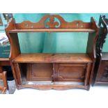 Light oak display unit with upper shelf,