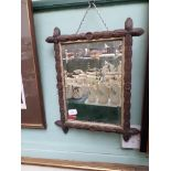 Small rectangular bevel edged mirror in decorative carved oak frame