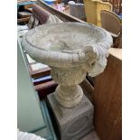 Larger urn shaped stone planter on square base