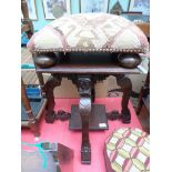 Most ornate table seat on 4 carved splayed feet with undershelf together with a studded padded
