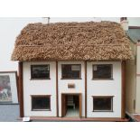 FINE THATCHED COTTAGE DOLLS HOUSE,